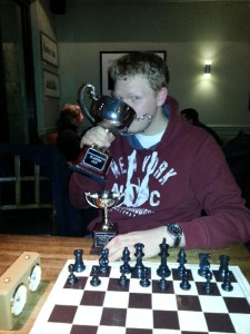 Liam enjoying a pint from the Players Cup Trophy