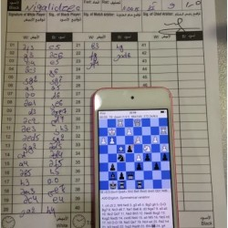 The score sheet and the phone which is analyzing the game.